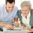 Royalty-Free Stock Photo: Happy father and son working on laptop