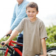 Royalty-Free Stock Photo: Sweet little boy and his grandfather on bicycles