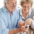 Happy old couple using a mobile phone - Foto Stock