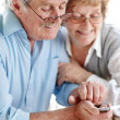 Royalty-Free Stock Photo: Lovely senior couple using a cellphone