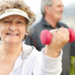 Royalty-Free Stock Photo: Senior woman doing exercise with a dumbell