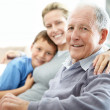 Senior man sitting with his daughter and grandson - Stockfoto
