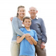 Royalty-Free Stock Photo: Sweet family standing together against bright background