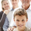Royalty-Free Stock Photo: Sweet little boy smiling while his family standing in background