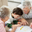 Royalty-Free Stock Photo: Elderly couple with their grandson making a drawing