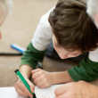 Royalty-Free Stock Photo: Adorable little boy making a drawing with his grandparents