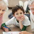 Royalty-Free Stock Photo: Old couple with their grandson making drawing