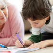 Royalty-Free Stock Photo: Sweet boy making drawing with his grandmother