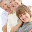 Royalty-Free Stock Photo: Sweet young boy standing with his grandparents in line