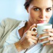 Pretty young female having a cup of coffee - Lizenzfreies Foto