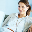 Happy young female sitting with a laptop - Foto de Stock