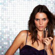 Stunning young female model in a disco - Stock Photo