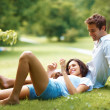 Royalty-Free Stock Photo: Romantic young couple relaxing in park