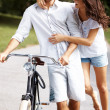 Royalty-Free Stock Photo: Romantic couple with a cycle walking together in park
