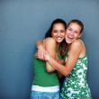 Royalty-Free Stock Photo: Friendship - Two girlfriends hugging eachother