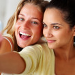 Self photography - Excited girls taking picture of themselves - Stock Photo