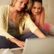 Pretty young girls working on laptop - Foto de Stock