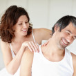 Royalty-Free Stock Photo: Mature woman giving a shoulder massage to her happy husband