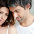 Closeup of unhappy mature couple together - Stock Photo