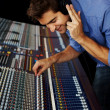 Young man in music recording studio - Stock Photo