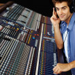Sound studio - Young man working on sound mixer console - Stock Photo