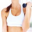 Beautiful young woman working out with free weights - Foto Stock