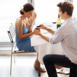 Young man propose marriage to beautiful girl in a restaurant - Foto Stock