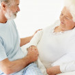 Royalty-Free Stock Photo: Caring mature man comforting a sick senior woman