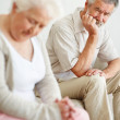 Royalty-Free Stock Photo: Tensed mature man looking at a sad senior woman