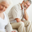 Royalty-Free Stock Photo: Depressed mature man looking at a sad senior woman