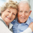Closeup portrait of a loving senior couple smiling - Stock Photo