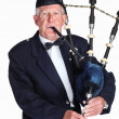Mature highlander with a bagpipes isolated against white - Stock Photo