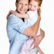 Grandmother holding her granddaughter isolated against white - Stock Photo