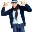 Royalty-Free Stock Photo: Funky style - Stylish young man shooting himself on white