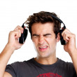 Royalty-Free Stock Photo: Young man expressing loud sound over the headphone