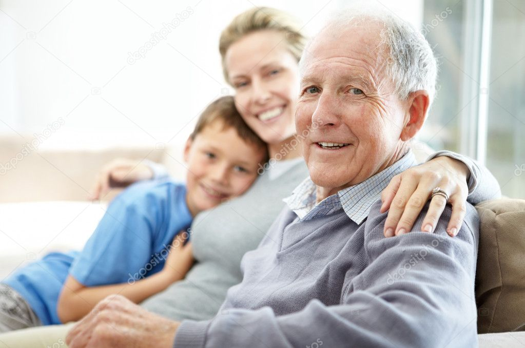 Closeup portrait of a senior man sitting with his daughter and grandson — Foto Stock #7710968