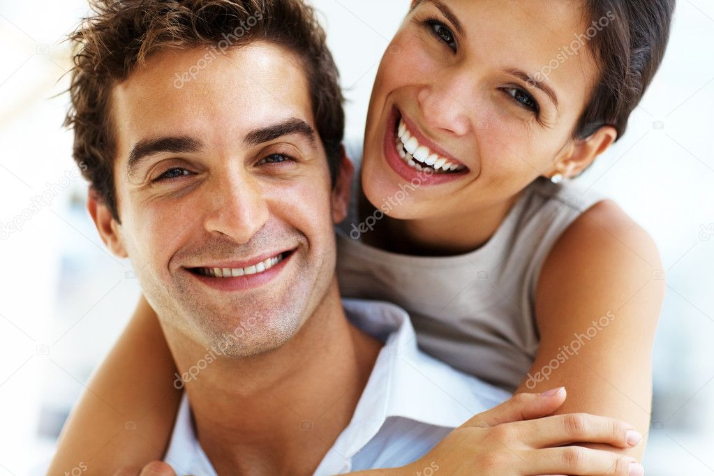 Closeup portrait of young beautiful couple smiling together and hugging — Stock Photo #7712504