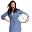 You are late - Angry young female screaming with a clock - Стоковая фотография
