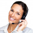 Female customer representative with headset smiling during a tel - Stock Photo