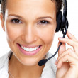 Royalty-Free Stock Photo: Happy young female call centre employee smiling with a headset