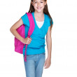 Happy little girl standing with schoolbag on white - Stock Photo