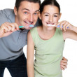 Royalty-Free Stock Photo: Handsome young man brushing with his daugther