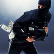 Bank robbery - Male thief running with handbag - Stock Photo