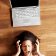 Frustration - Young woman shouting with laptop - Stock Photo