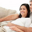 Royalty-Free Stock Photo: Loving mature couple sitting together on couch