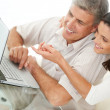 Royalty-Free Stock Photo: Mature couple browsing internet on a laptop