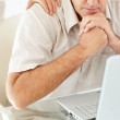 Mature man looking at laptop in tension - Lizenzfreies Foto
