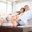 Royalty-Free Stock Photo: Happy mature couple relaxing together in couch