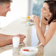 Happy mature couple having breakfast together - Stock Photo