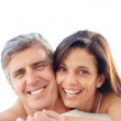 Lovely mature woman embracing her husband - Stock Photo